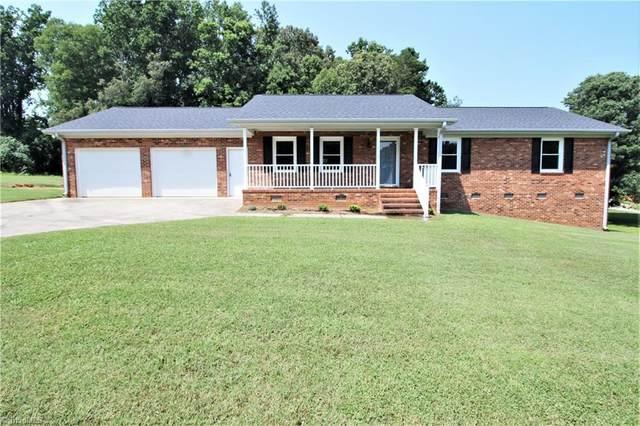 1213 Kalon Drive, Browns Summit, NC 27214 (MLS #1036360) :: Ward & Ward Properties, LLC