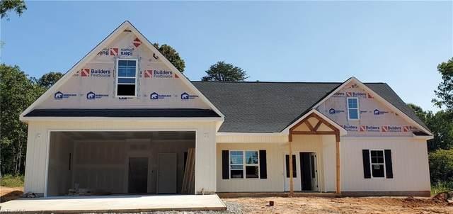 7902 Pate Drive, Oak Ridge, NC 27310 (MLS #1042044) :: Ward & Ward Properties, LLC
