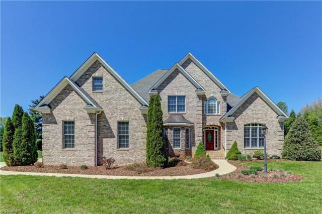 7025 Carriage Cove Drive, Oak Ridge, NC 27310 (MLS #883155) :: Kristi Idol with RE/MAX Preferred Properties