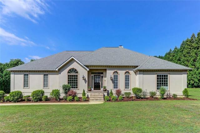 6015 Beckenham Way, Oak Ridge, NC 27310 (MLS #891066) :: Kristi Idol with RE/MAX Preferred Properties