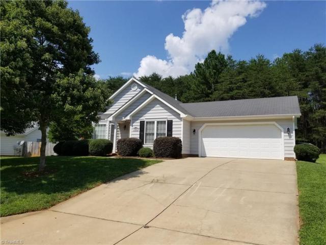 5802 Highland Grove Drive, Summerfield, NC 27358 (MLS #900006) :: Lewis & Clark, Realtors®