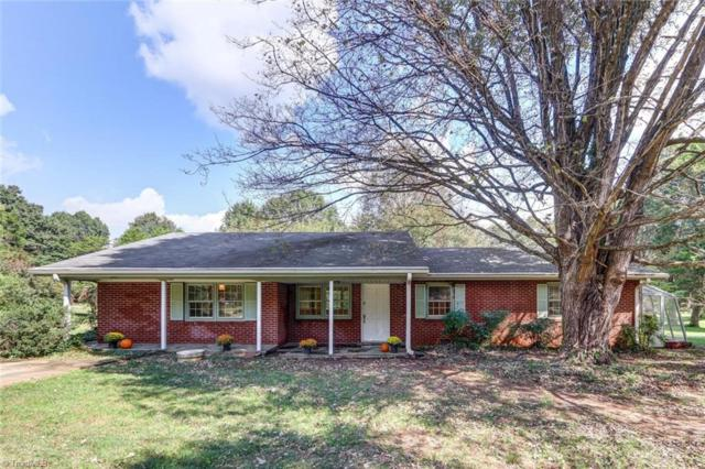 2410 Oak Ridge Road, Oak Ridge, NC 27310 (MLS #906234) :: Lewis & Clark, Realtors®