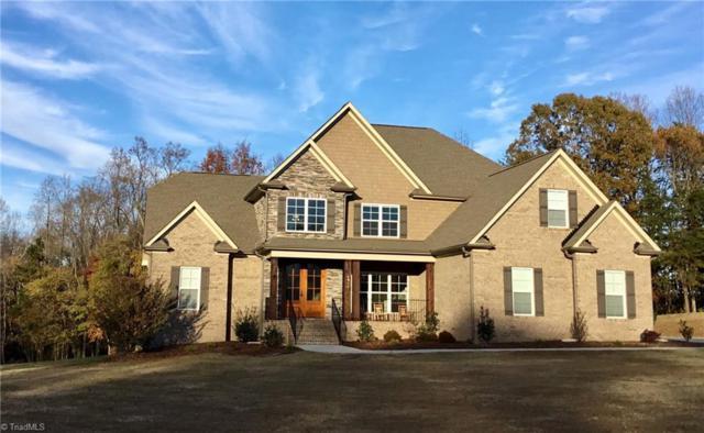 5714 Oakhurst Downs Drive, Oak Ridge, NC 27310 (MLS #910827) :: NextHome In The Triad