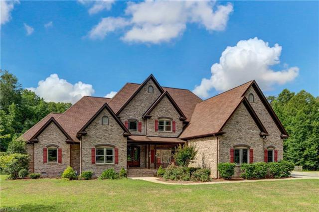 7900 Hoskins Ridge Drive, Summerfield, NC 27358 (MLS #914084) :: The Temple Team