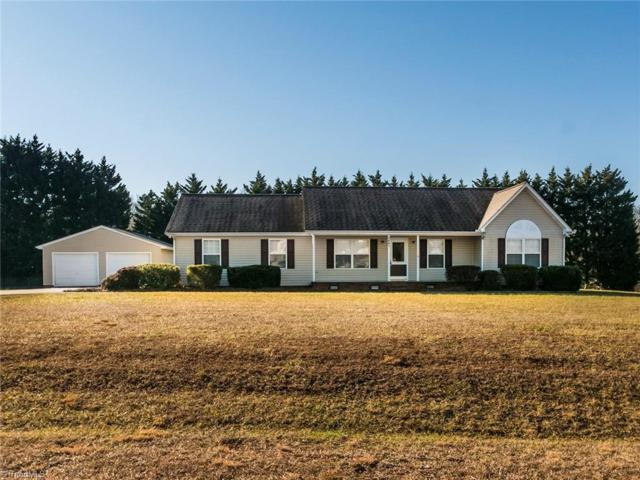 5802 Harvest Springs Drive, Greensboro, NC 27406 (MLS #916237) :: NextHome In The Triad