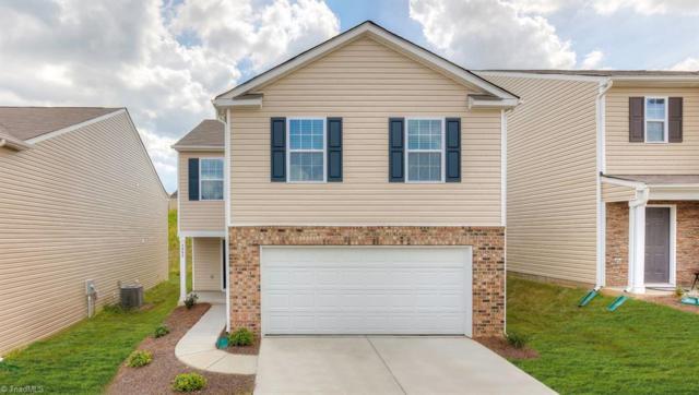 4450 Oak Pointe Drive, Winston Salem, NC 27105 (MLS #927439) :: HergGroup Carolinas