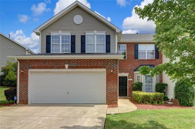 1911 Munn Pointe Drive, Whitsett, NC 27377 (MLS #940697) :: HergGroup Carolinas | Keller Williams