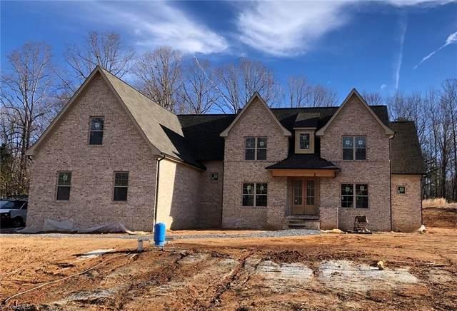 8606 Lathans Trail, Oak Ridge, NC 27310 (MLS #1006060) :: Greta Frye & Associates | KW Realty Elite
