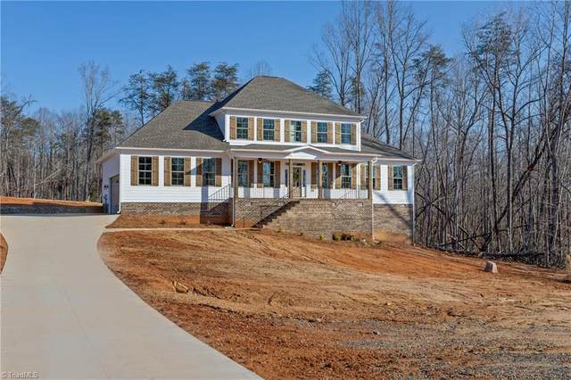 7094 Lambert Lake Road, Stokesdale, NC 27357 (MLS #1013182) :: HergGroup Carolinas | Keller Williams