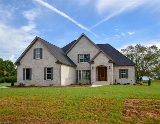 7402 Felloes Court, Oak Ridge, NC 27310 (MLS #906220) :: Lewis & Clark, Realtors®