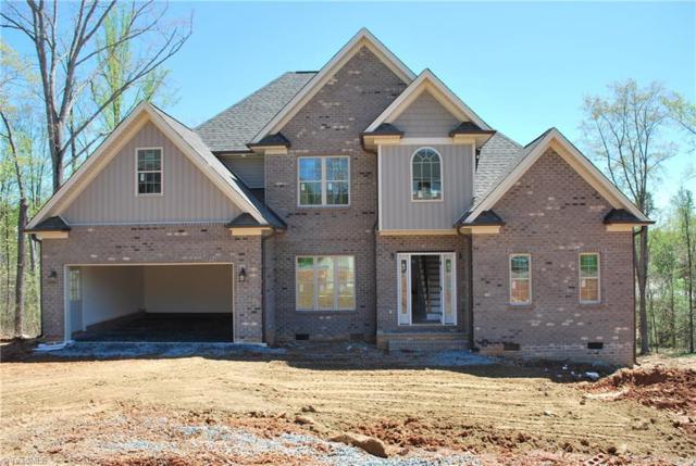 6540 Fieldmont Manor Drive, Tobaccoville, NC 27050 (MLS #909550) :: HergGroup Carolinas