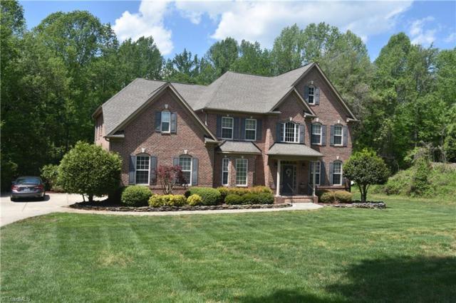 7884 Newhaven Drive, Oak Ridge, NC 27310 (MLS #929303) :: HergGroup Carolinas
