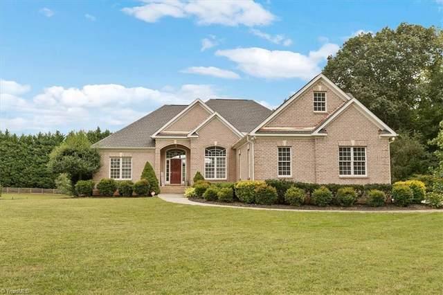 5618 Cape Fox Drive, Oak Ridge, NC 27310 (MLS #1041127) :: Lewis & Clark, Realtors®