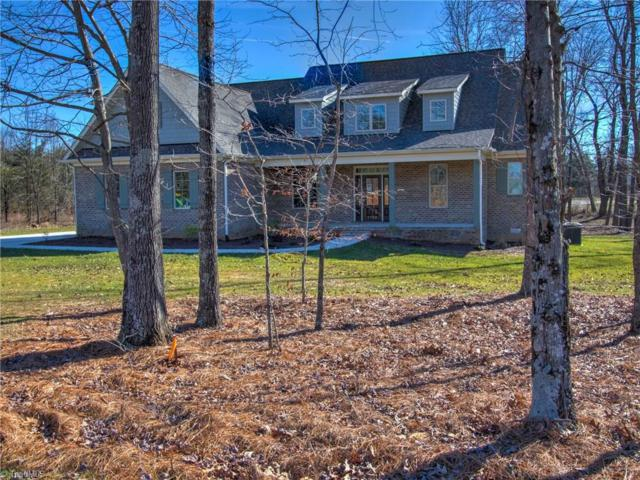 7703 Honkers Hollow Court, Stokesdale, NC 27357 (MLS #881442) :: Kristi Idol with RE/MAX Preferred Properties