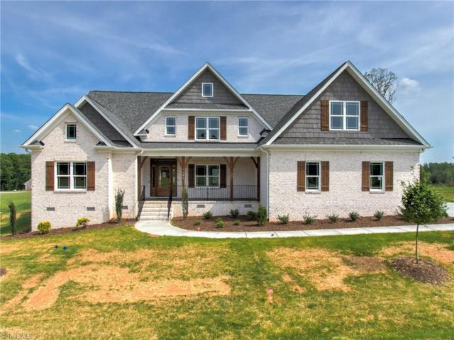 7306 Harkwood Trail, Oak Ridge, NC 27310 (MLS #915762) :: HergGroup Carolinas