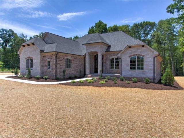 8209 Paso Fino Trail, Summerfield, NC 27358 (MLS #889400) :: Kristi Idol with RE/MAX Preferred Properties