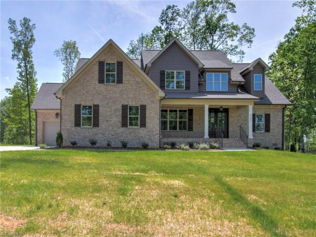 8101 Poplar Bluff Drive, Stokesdale, NC 27357 (MLS #915291) :: HergGroup Carolinas