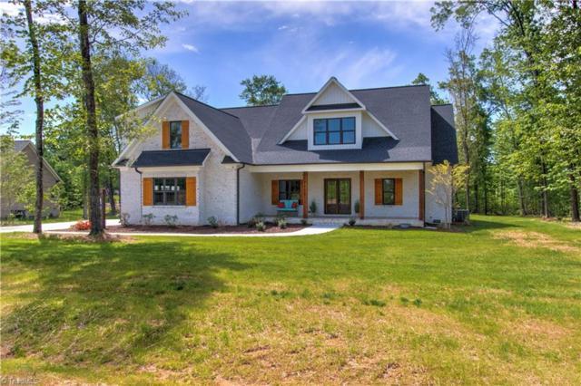 7705 Honkers Hollow Court, Stokesdale, NC 27357 (MLS #903453) :: HergGroup Carolinas