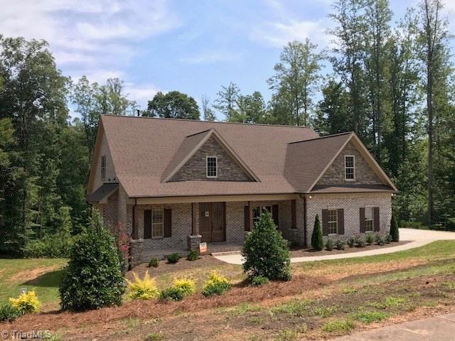 8300 Poplar Bluff Drive, Stokesdale, NC 27357 (MLS #858101) :: Kristi Idol with RE/MAX Preferred Properties