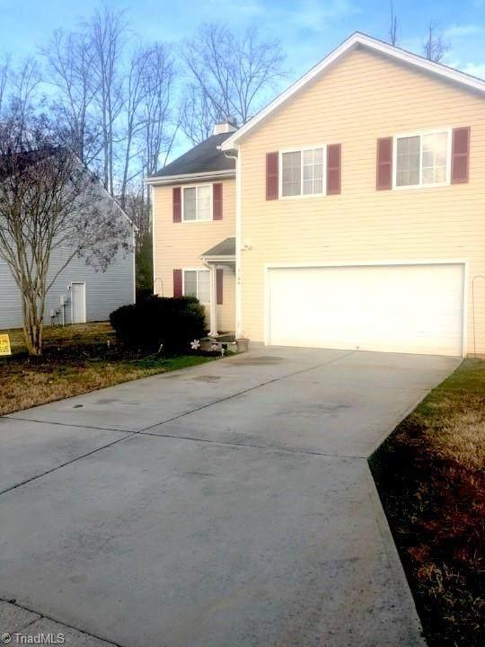 5706 Hiddenlake Drive, Browns Summit, NC 27214 (MLS #1014032) :: Lewis & Clark, Realtors®