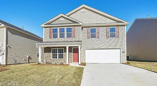 6854 Keeneland Drive, Whitsett, NC 27377 (#1044899) :: Mossy Oak Properties Land and Luxury