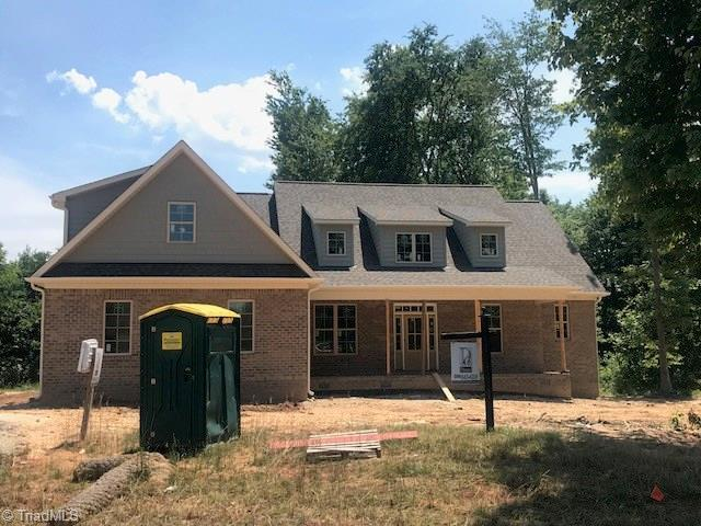 7703 Honkers Hollow Drive, Stokesdale, NC 27357 (MLS #881442) :: Kristi Idol with RE/MAX Preferred Properties