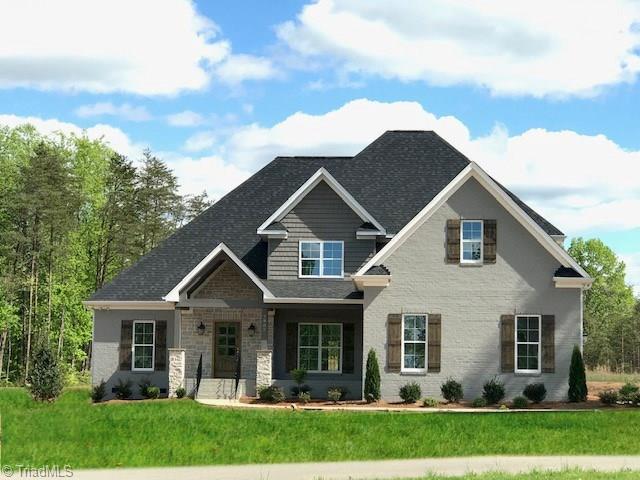 7902 Honkers Hollow Drive, Stokesdale, NC 27357 (MLS #909962) :: HergGroup Carolinas