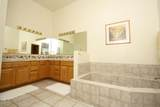 9884 Ridge Shadow Place - Photo 16