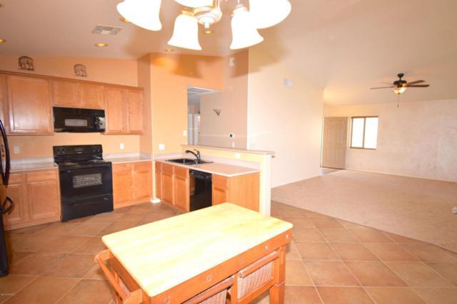 6721 S Camino Catalan, Tucson, AZ 85757 (#21807872) :: Long Realty Company