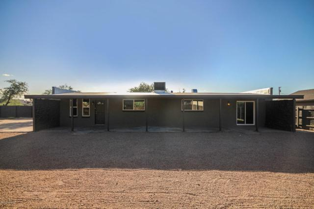 705 W Simmons Road, Tucson, AZ 85705 (#21824572) :: Long Realty - The Vallee Gold Team