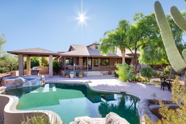 6560 N Camino Lenor, Tucson, AZ 85743 (#21825209) :: Long Realty - The Vallee Gold Team