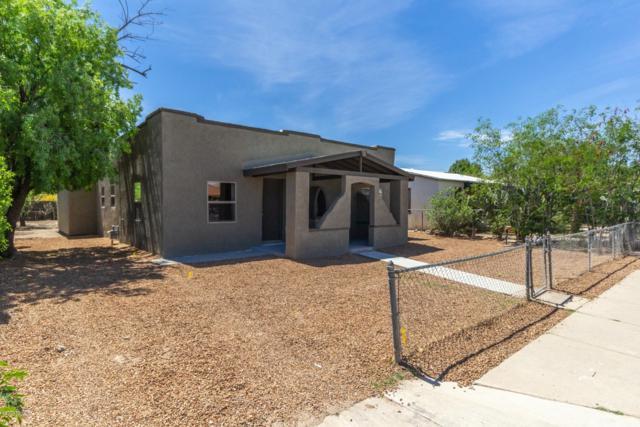1009 W Huron Street, Tucson, AZ 85745 (#21909885) :: Long Realty - The Vallee Gold Team