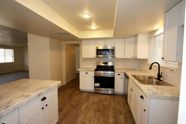 9041 E 31st Place, Tucson, AZ 85710 (#21802861) :: Long Realty Company