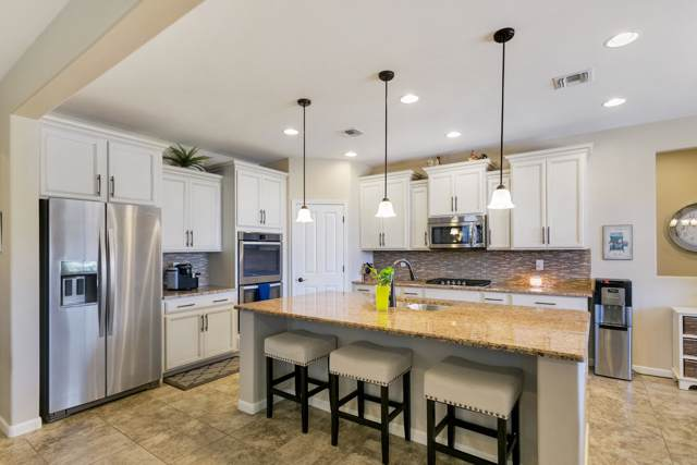 2321 W Sculptor Street, Oro Valley, AZ 85742 (#21925345) :: Long Realty - The Vallee Gold Team