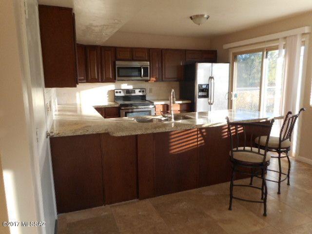 8000 N Placita Feliz, Tucson, AZ 85704 (#21729456) :: Long Realty - The Vallee Gold Team