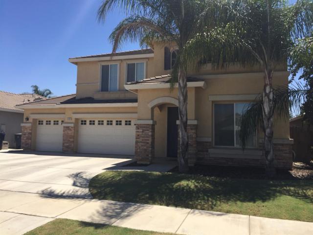 3135 W Buena Vista Avenue, Visalia, CA 93291 (#132190) :: Robyn Graham & Associates