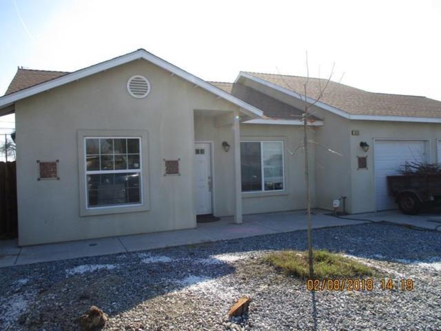 815 E Myrtle Street, Hanford, CA 93230 (#136952) :: Robyn Graham & Associates