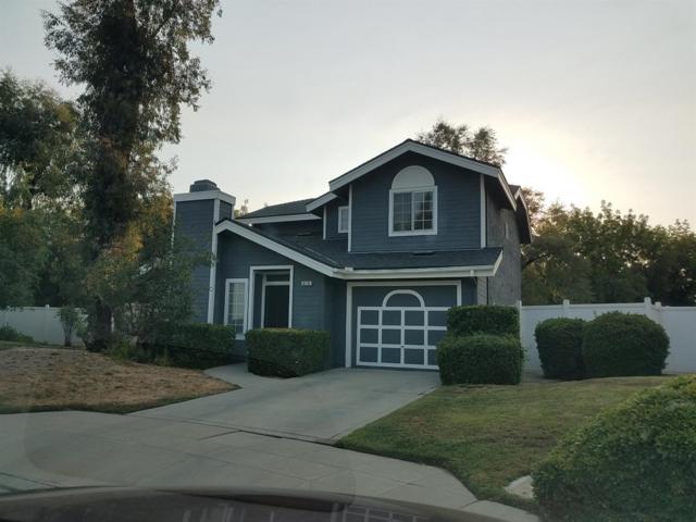 616 E Rock Creek Lane, Fresno, CA 93730 (#140270) :: Robyn Graham & Associates