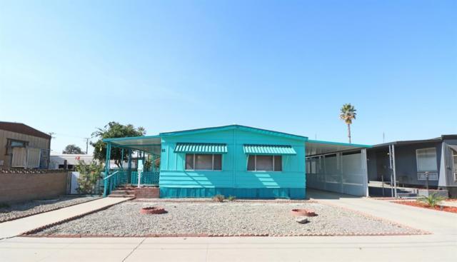 560 W Pleasant Avenue #82, Tulare, CA 93274 (#142038) :: The Jillian Bos Team