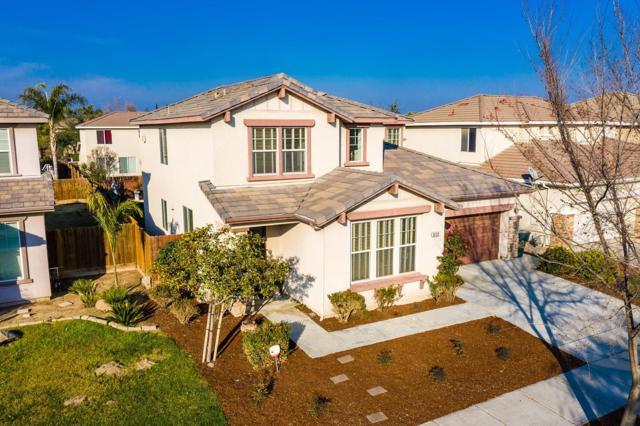 3122 W Sweet Avenue, Visalia, CA 93291 (#143240) :: Robyn Graham & Associates