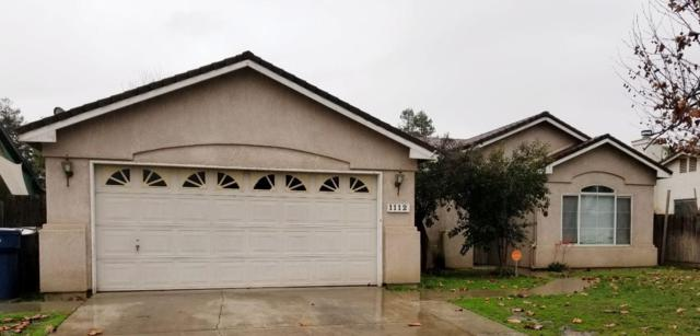 1112 Hillsboro Street, Tulare, CA 93274 (#143468) :: The Jillian Bos Team