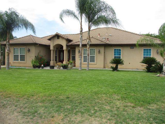 336 N Riverside Drive, Woodlake, CA 93286 (#145175) :: The Jillian Bos Team