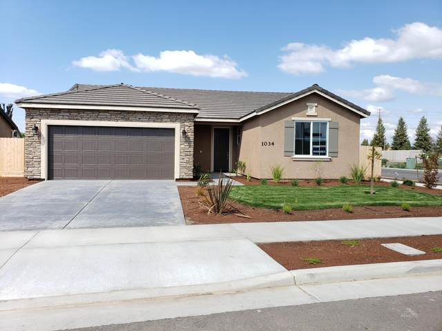 1034 E Country Court, Visalia, CA 93292 (#204079) :: Martinez Team