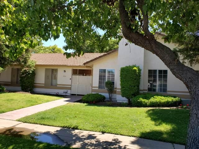 4014 Benedict Avenue, Fresno, CA 93722 (#204793) :: The Jillian Bos Team