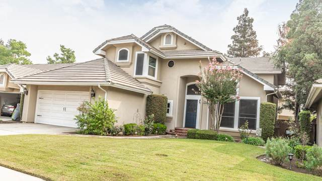 9314 N Bayford Street, Fresno, CA 93720 (#206979) :: Robyn Icenhower & Associates
