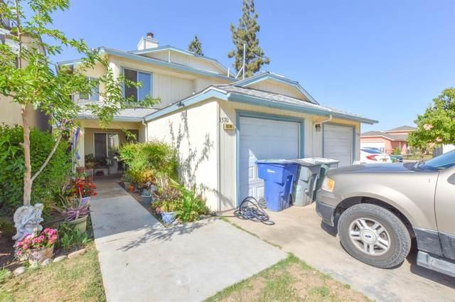 3570 W Terrace Avenue, Fresno, CA 93722 (#211013) :: The Jillian Bos Team