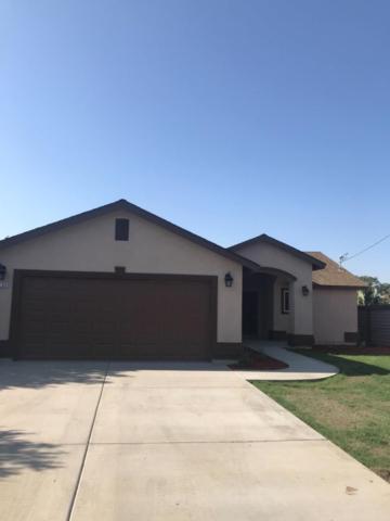 1233 E Ellsworth Avenue, Pixley, CA 93256 (#140621) :: Robyn Graham & Associates