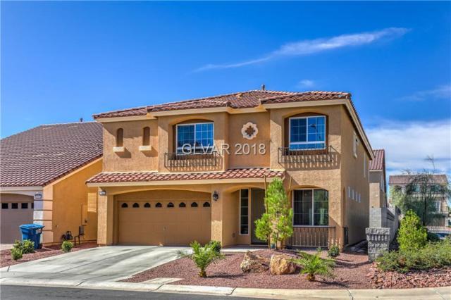 10661 Parthenon, Las Vegas, NV 89183 (MLS #2043912) :: The Machat Group | Five Doors Real Estate