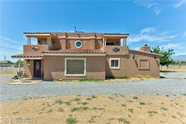1230 E Pluto, Pahrump, NV 89048 (MLS #2106153) :: Signature Real Estate Group