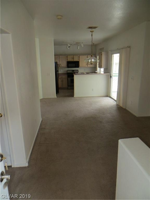 6905 Squaw Mountain #202, Las Vegas, NV 89130 (MLS #2069220) :: The Snyder Group at Keller Williams Marketplace One